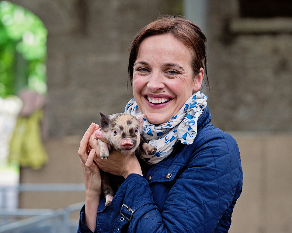 President of The Irish Pig Society, Ella  McSweeney   with a Kune Kune piglet - jennifer o'sullivan
